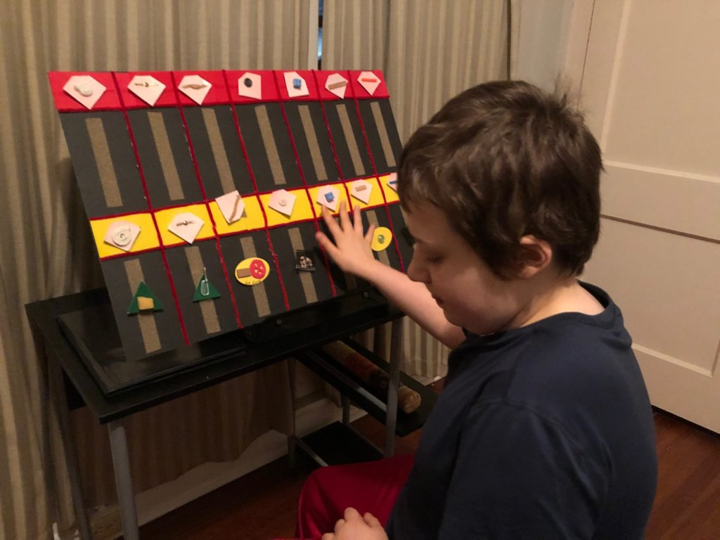 Eddie interacting with a tactile calendar