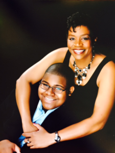 A professional photograph of Vera Jones and her son.