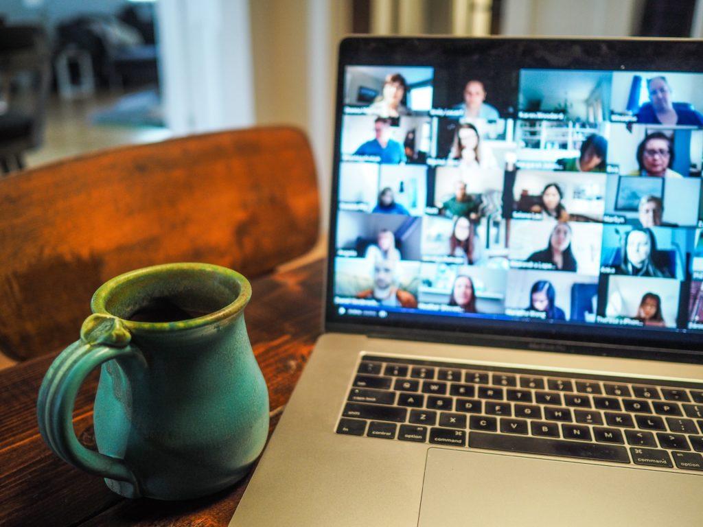 laptop screen showing people attending a webinar