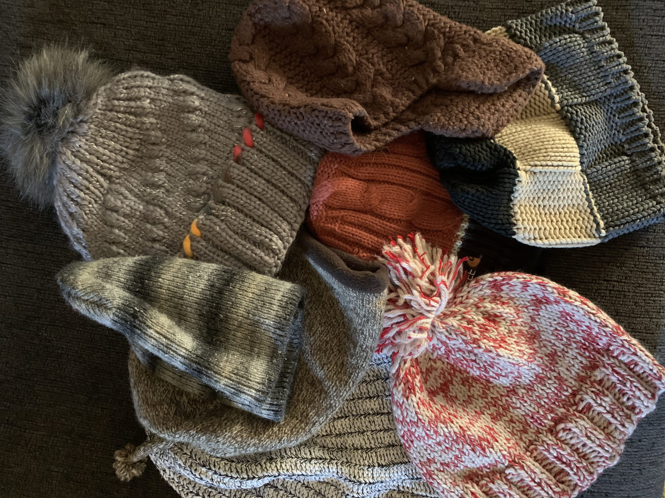 A pile of knitted hats